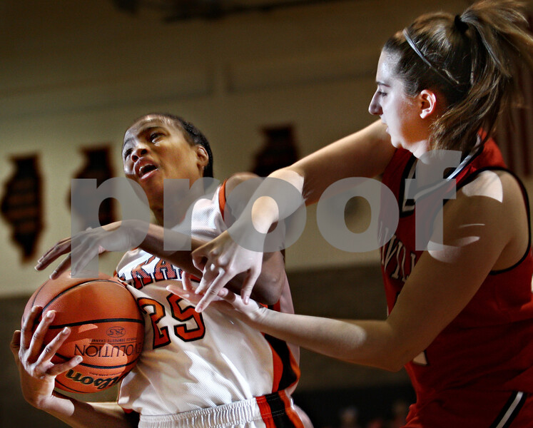 Beck Diefenbach  -  bdiefenbach@daily-chronicle.com<br /> <br /> DeKalb guard Michelle Todd (25, left) fights for the ball with Yorkville forward Kourtney Mizel (24) during the first quarter of the game at DeKalb High School in DeKalb, Ill., on Tuesday Jan 13, 2008.