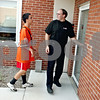 Rob Winner – rwinner@daily-chronicle.com<br /> Josh Waffle (left) and his Big Brother Doug Teckenbrock head into the Opportunity House in Sycamore on Tuesday afternoon.<br /> 08/04/2009
