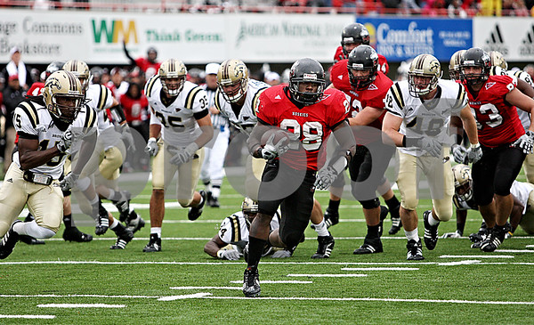 Rob Winner – rwinner@daily-chronicle.com<br /> Northern's Chad Spann is able to break through Western Michigan's defense for a touchdown run in the first half. Northern Illinois went on to defeat Western Michigan 38-3 on Saturday.<br /> 10/03/2009