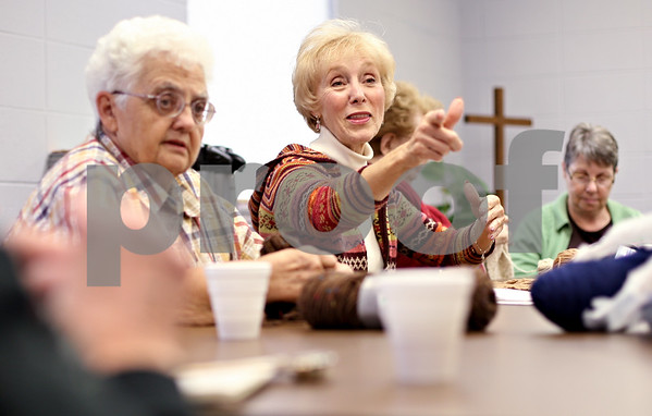 "Beck Diefenbach  -  bdiefenbach@daily-chronicle.com<br /> <br /> Judy Gontko (right), of Kirkland, talks with her knitting group as part of ""compassionate ministries"" at St. Catherine of Genoa Church on Tuesday Nov. 17, 2009."