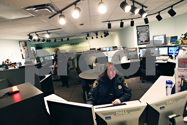 Beck Diefenbach  -  bdiefenbach@daily-chronicle.com<br /> <br /> Deputy Kim Stiles attends to a 911 call as a telecommunicator for the DeKalb County Sheriffs Office in Sycamore, Ill., on Friday April 10, 2009.