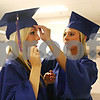 Randi Stella – rstella@daily-chronicle.com<br /> <br /> Morgan Hickey (right) helps Jamie Miller (left) with her mortar board before graduation at Genoa-Kingson High School, Wednesday May 15th, 2009.