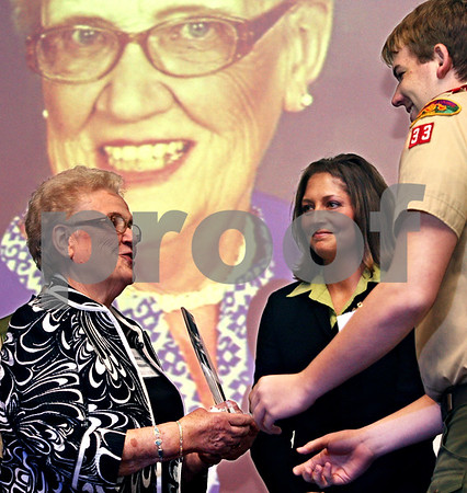 Beck Diefenbach  -  bdiefenbach@daily-chronicle.com<br /> <br /> Yvonne Johnson, of Sycamore, Ill., receives her award for her work in education during the Tribute to Heroes presentation at Kishwuakee College in Malta, Ill., on Thursday Oct. 1, 2009.