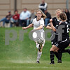 Beck Diefenbach  -  bdiefenbach@daily-chronicle.com<br /> <br /> Sycamore's Krista Koeplin (5) kicks the ball during the second half of the game against Sycamore High School at Sycamore High School in Sycamore, Ill., on Thursday April 30, 2009. Sycamore beat DeKalb 4 to 0.
