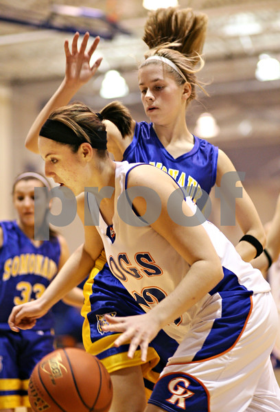 Beck Diefenbach  -  bdiefenbach@daily-chronicle.com<br /> <br /> Genoa-Kingston's Mariah Sartorius (13, bottom) dribbles past Somonauk's Audrey Weismiller (31) during the third quarter of the game of the G-K Christmas Tournament at G-K High School in Genoa, Ill., on Tuesday Dec. 15, 2009.