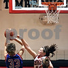 Beck Diefenbach  -  bdiefenbach@daily-chronicle.com<br /> <br /> Indian Creek senior Devon White (11) attempts to block a shot by Hinckley-Big Rock sophomore Tess Godhardt (33) during the first quarter of the game at Indian Creek High School in Shabbona, Ill., on Thursday Jan. 29, 2009. HBR beat Indian Creek 61 to 41.