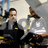 Rob Winner – rwinner@daily-chronicle.com<br /> Alex Bonaire (left) and Bill Lawson, both of Fanuc Robotics, help calibrate a conveyor belt robotic system at Smart Motion Robotics in Sycamore on Wednesday. DeKalb County is making it a priority to attract high-tech companies that employ high-paid workers.<br /> 07/08/2009