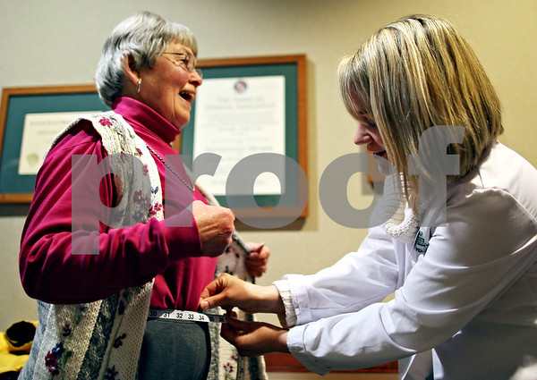 "Beck Diefenbach – bdiefenbach@daily-chronicle.com<br /> <br /> Left, Corki Williams, of Sycamore, breaths in as Lynn Fifer, Kishwaukee Hospital registered dietitian, measures the circumference of Williams' waist for the first weigh-in for ""Weight No More,"" at Kishwaukee Hospital in DeKalb, Ill., on Monday March 2, 2009."