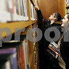 Rob Winner – rwinner@daily-chronicle.com<br /> Friends Nayeli Villa (front) and Lucero Martinez, both of Sandwich, pick out a handful of DVDs to check out at the Sandwich District Library in Sandwich, Ill. on Wednesday December 30, 2009.