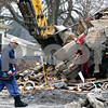 Beck Diefenbach  -  bdiefenbach@daily-chronicle.com<br /> <br /> A postman walks by as demolition crews tear down the three-unit building at 808 E. Lincoln Hwy in DeKalb, Ill., on Monday Feb. 9, 2009. The building had been partially destroyed in a fire on Dec. 4, 2008.