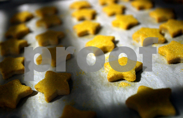 Beck Diefenbach  -  bdiefenbach@daily-chronicle.com<br /> <br /> Star cookies sit on racks at Baker's Buddy to be sold in the Neighborhood Bakery in DeKalb, Ill., on Tuesday Jan. 27, 2009. Owner John Henner has halted baking with peanut butter, even though he doesn't sell any products with raw peanut butter and salmonella is even killed in the oven process.