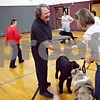 Beck Diefenbach  -  bdiefenbach@daily-chronicle.com<br /> <br /> Donna Bunton, of Kingston, practices congratulating Damian Burke, of Somonauk, during a dog showmanship class at the Haish Gym in DeKalb, Ill., on Thursday March 26, 2009.