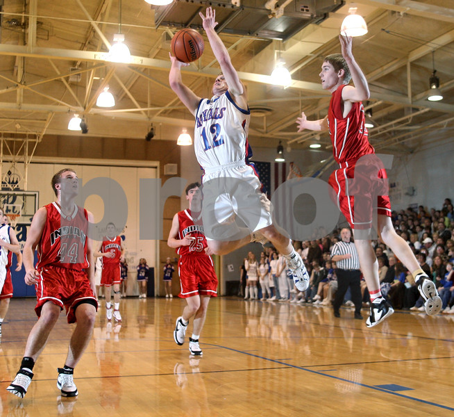 Beck Diefenbach – bdiefenbach@daily-chronicle.com<br /> <br /> Hinckley-Big Rock's Brian Michaels (12) shoots the ball between Indian Creek's Nathan Peterson (44) and Matt Davis (33) during the first quarter of the game at H-BR High School in Hinckley, Ill., on Friday Feb. 20, 2009.