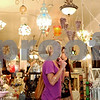 Rob Winner – rwinner@daily-chronicle.com<br /> NIU students Katie Wiencek (left) and Stephanie Coppola look up at the numerous lamps hanging from the ceiling at Cracker Jax in DeKalb on Saturday afternoon. Seven downtown business owners are currently doing expansions and renovations, including Cracker Jax, a testament to their confidence in both the city's investment on street projects and confidence that the recession will turn around and consumer spending will rise again. <br /> 07/18/2009