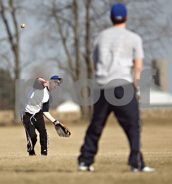 Beck Diefenbach  -  bdiefenbach@daily-chronicle.com<br /> <br /> Hinckley-Big Rock's Ryan Michaels heaves the ball during practice at HBR High School in Hinckley, Ill., on Monday March 16, 2009.