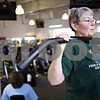 Beck Diefenbach  -  bdiefenbach@daily-chronicle.com<br /> <br /> Corki Williams, of Sycamore, does assisted pull ups during her circuit training class at the Kishwaukee YMCA in Sycamore, Ill., on Wednesday April 15, 2009.