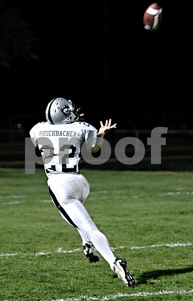 Rob Winner –  rwinner@daily-chronicle.com<br /> Kaneland's Quinn Buschbacher prepares to catch a Joe Camiliere touchdown pass in the second quarter.<br /> 09/18/2009