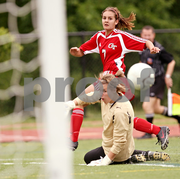 Beck Diefenbach  -  bdiefenbach@daily-chronicle.com<br /> <br /> Cathum Glenwood's Dani Torry (top) watches as her shot passes Sycamore goal keeper Sarah Fischer for another goal during the first half of the Class 2A third place tournament game at North Central College in Naperville, Ill., on Saturday June 6, 2009. Sycamore lost 1 to 2, taking fourth place in the tournament.