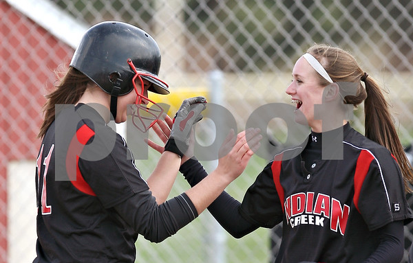 Beck Diefenbach  -  bdiefenbach@daily-chronicle.com<br /> <br /> Left, Indian Creek's Carol Jensky (11) is congratulated by teammate Jenna Holm (3) after hitting her first of two home runs during the first inning of the game against Hiawatha at Indian Creek High School in Shabbona, Ill., on Monday April 20, 2009.