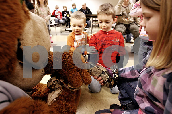 Rob Winner – rwinner@daily-chronicle.com<br /> Brothers Carson Matthews (left), 3, and Cooper, 6, both of Sycamore, touch the skin of Nelson, a Boa constrictor, at the Midwest Museum of Natural History in Sycamore, Ill. on Wednesday December 30, 2009. Nelson is the museum's first ever mascot.