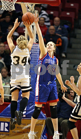 Beck Diefenbach – bdiefenbach@daily-chronicle.com<br /> <br /> Hinckley-Big Rock center Melissa Herrmann attempts to block a shot by Winchester West Central guard Keri Lietz (34) during the first quarter of the Class 1A State Championship at the Redbird Arena in Normal, Ill., on Saturday Feb. 28, 2009.