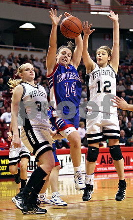 Beck Diefenbach – bdiefenbach@daily-chronicle.com<br /> <br /> Hinckley-Big Rock guard Kaitlin Phillips (14) loses the ball after she is fouled by Winchester West Central High School center Tomi White (30) during the third quarter of the Class 1A IHSA State Basketball Championships at the Red Bird Arena in Normal, Ill., on Saturday Feb. 28, 2009.