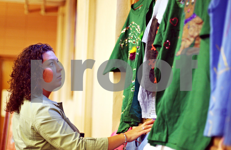 """Beck Diefenbach  -  bdiefenbach@daily-chronicle.com<br /> <br /> Safe Passage member Maria O'Brian looks at t-shirts artwork designed by sexual abuse victims during the """"A Community United"""" event against sexual violence at First Congregational United Church in DeKalb, Ill., on Monday April 6, 2009. The event was hosted by Safe Passage in observance of Sexual Assault Awareness Month."""