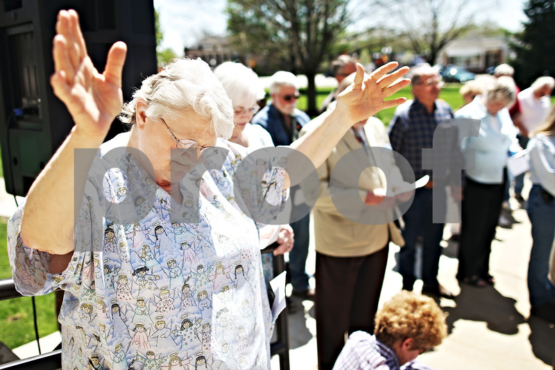 """Beck Diefenbach  -  bdiefenbach@daily-chronicle.com<br /> <br /> Marge Beyer, of DeKalb, takes part in National Day of Prayer outside the DeKalb County Courthouse  in Sycamore, Ill., on Thursday May 7, 2009. """"I just think this is so important for us,"""" Beyer said."""