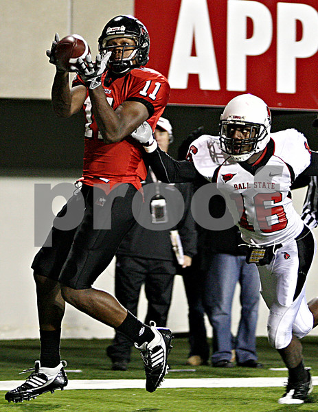 Rob Winner – rwinner@daily-chronicle.com<br /> Wide Receiver Marcus Lewis (11) hauls in a Chandler Harnish touchdown pass in the third quarter. NIU defeated Ball State 26-20.<br /> 11/12/2009