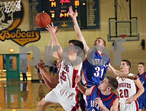 Beck Diefenbach  -  bdiefenbach@daily-chronicle.com<br /> <br /> Hinkcley-Big Rock's Ryan Korth (31) trails Indian Creek's Seth Sanderson (25) as he shoots the ball during he second quarter of the Little 10 consolation game at Somonauk High School in Somonauk, Ill., on Friday Feb. 6, 2009.