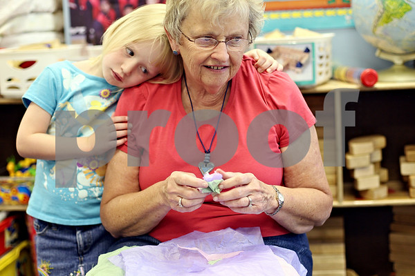 Beck Diefenbach  -  bdiefenbach@daily-chronicle.com<br /> <br /> Emma Friedland, 5, leans her head on her teacher Diane Guhl during class at The Growing Place in DeKalb, Ill., on Friday June 5, 2009.