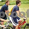 Beck Diefenbach  -  bdiefenbach@daily-chronicle.com<br /> <br /> Aaron Pasch, of Sycamore, leads a group of friends on a bike ride through a park behind the North Elementary School in Sycamore, Ill., on Tuesday July 14, 2009