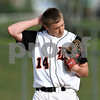 Beck Diefenbach  -  bdiefenbach@daily-chronicle.com<br /> <br /> DeKalb's pitcher Ben Dallesasse (14) reacts after allowing back-to back RBIs during the top of the third inning of the game against Geneva at Dekalb High School in DeKalb, Ill., on Tuesday May 12, 2009.