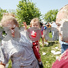Beck Diefenbach  -  bdiefenbach@daily-chronicle.com<br /> <br /> Alicia Irlbeck, of Genoa, and her son Connor Hughes, 1, are covered in pie during the world's largest pie fight in Genoa, Ill., on Saturday June 13, 2009. Over 200 people participated.