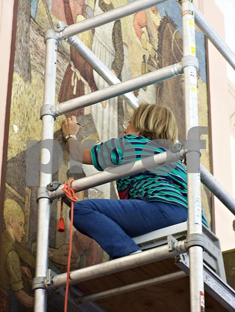 The restoration of the mural in the library.
