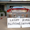 "Beck Diefenbach  -  bdiefenbach@daily-chronicle.com<br /> <br /> A sign protesting the possible layoffs of DeKalb firefighters sits next to car at the house of Fred Fletcher in DeKalb, Ill., on Monday June 22, 2009. ""I stand behind these (firefighters),"" Fletcher said. ""They work hard."""