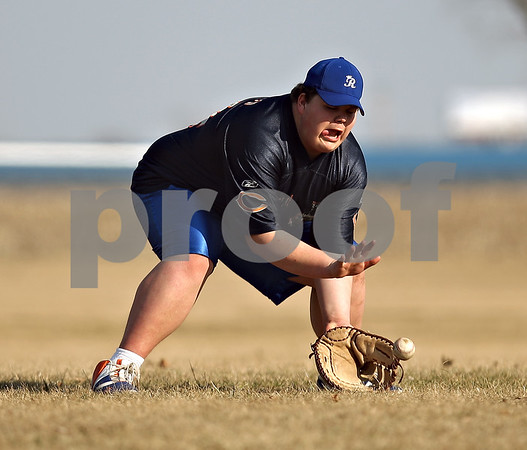 Beck Diefenbach  -  bdiefenbach@daily-chronicle.com<br /> <br /> Hinckley-Big Rock's Kyle Phillips fields a ground ball during practice at HBR High School in Hinckley, Ill., on Monday March 16, 2009.