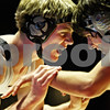 Beck Diefenbach  -  bdiefenbach@daily-chronicle.com<br /> <br /> Kaneland's Chris Sabal fights off his opponent during the 145-pound match at DeKalb High School in DeKalb, Ill., on  Friday Dec. 11, 2009.
