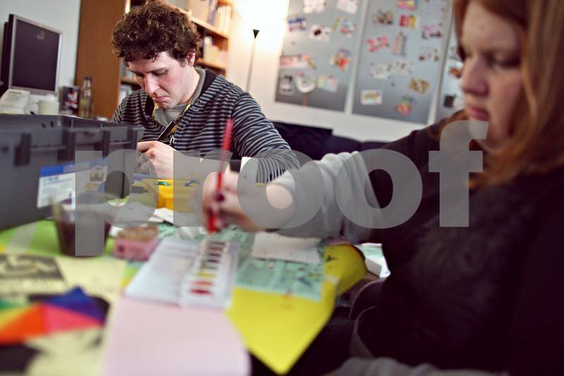 Beck Diefenbach  -  bdiefenbach@daily-chronicle.com<br /> <br /> Left, LGBT Resource Center staff member Phillip Engleking and Northern Illinois University freshman Jen Yesaitis design their postcards to be contributed to the art work on display at the LGBT Recourse Center on the NIU campus in DeKalb, Ill., on Wednesday April 1, 2009.