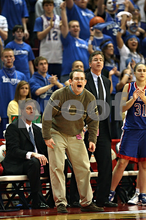 Beck Diefenbach – bdiefenbach@daily-chronicle.com<br /> <br /> Hinckley-Big Rock head coach Greg Burks calls out to his players during the second quarter of the Class 1A State Championship against Winchester West Central at the Redbird Arena in Normal, Ill., on Saturday Feb. 28, 2009.