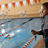 Beck Diefenbach  -  bdiefenbach@daily-chronicle.com<br /> <br /> Coach Leah Eames times her swimmers during practice at the DeKalb High School swimming pool in DeKalb, ill., on Wednesday Sept. 2, 2009.