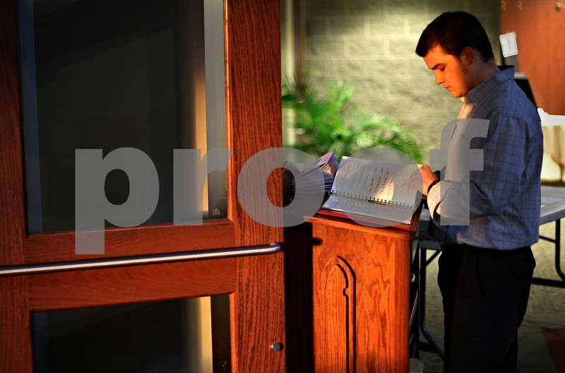 Beck Diefenbach – bdiefenbach@daily-chronicle.com<br /> <br /> David Kolozow, an elder at St. John's Lutheran Church, sifts through the church's guest book before the start of the Ash Wednesday dinner at St. john's Lutheran Church in Sycamore, Ill., on Wednesday Feb. 25, 2009.