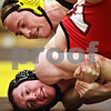 Beck Diefenbach  -  bdiefenbach@daily-chronicle.com<br /> <br /> Sycamore's Kyle Culton handles Yorkville's Sean Anderson during the 140 lbs match of the game at Sycamore, Ill., on Thursday Dec. 3, 2009.