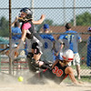 Beck Diefenbach  -  bdiefenbach@daily-chronicle.com<br /> <br /> Kishwaukee Valley Storm catcher Tristyn Criswell (00) can't reach the ball as Schaumburg Slugger Allison Naujokas slides safe into home during a 14-under game of Storm Dayz in Sycamore, Ill., on Friday June 26, 2009.