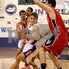 Rob Winner – rwinner@daily-chronicle.com<br /> Genoa-Kingston's Nick Lopez moves the ball past Yorkville defender Luke Parece during the first half of their game on Monday December 28, 2009 in Plano, Ill.
