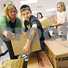 Beck Diefenbach  -  bdiefenbach@daily-chronicle.com<br /> <br /> Fifth grader Ryan Piloni helps teacher Brooke Wright stack boxes of canned food as part of the Freezing for Food Drive at South Prairie Elementary School in Sycamore, Ill., on Monday Nov. 30, 2009.