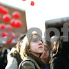 Beck Diefenbach  -  bdiefenbach@daily-chronicle.com<br /> <br /> Northern Illinois University student Jenna Binversie watches as 500 balloons as released by the Huskies United group in DeKalb, Ill., on Thursday Feb. 14, 2009.