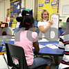 Rob Winner –  rwinner@daily-chronicle.com<br /> Lauren Peckham, of Tyler Elementary School in DeKalb, works with a group of first graders during a reading lesson on Wednesday morning.<br /> <br /> Tamiah Griffin - pink<br /> 09/16/2009