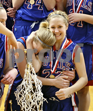 Beck Diefenbach – bdiefenbach@daily-chronicle.com<br /> <br /> Hinckley-Big Rock's Maxzine Rossler, right, embraces Jes Meyer, left, after defeating Winchester West Central in the Class 1A State Championship at the Redbird Arena in Normal, Ill., on Saturday Feb. 28, 2009.