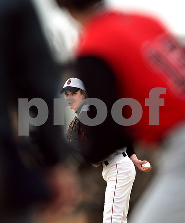 Beck Diefenbach  -  bdiefenbach@daily-chronicle.com<br /> <br /> Indian Creek pitcher Josh Lazzarotto prepares to throw the ball during the top of the first inning of the game against Amboy High School at Indian Creek High School in Shabbona, Ill., on Friday March 27, 2009.